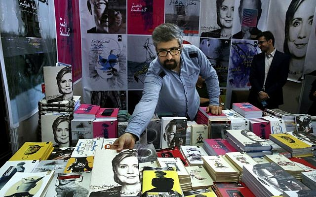 """In this picture taken on Tuesday, May 10, 2016, a book seller arranges then US presidential candidate Hillary Clinton's book """"Hard Choices"""" translated to Persian during Tehran's International Book Fair. (AP Photo/Vahid Salemi)"""