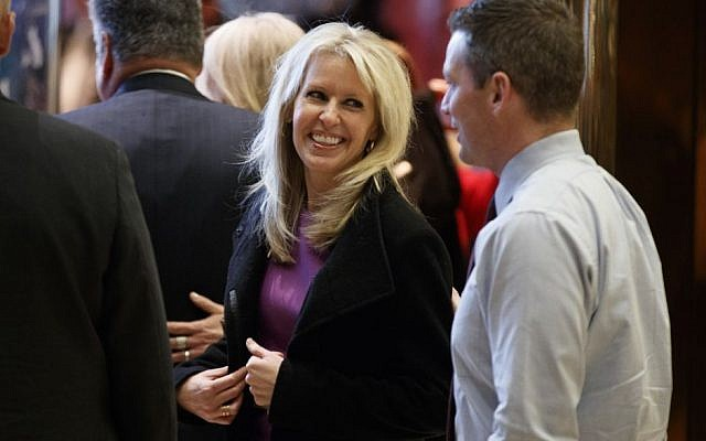 Monica Crowley smiles as she exits the elevator in the lobby of Trump Tower in New York, Thursday, Dec. 15, 2016 (AP Photo/Evan Vucci)