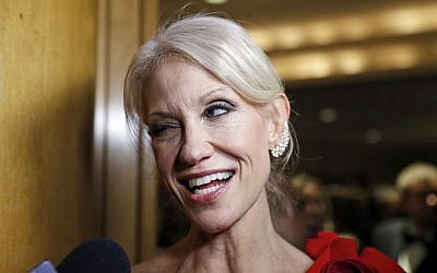 Trump adviser Kellyanne Conway winks as she speaks with reporters at the Indiana Inaugural Ball for Vice president-elect Mike Pence, Thursday, Jan. 19, 2017 in Washington. (AP Photo/Alex Brandon)