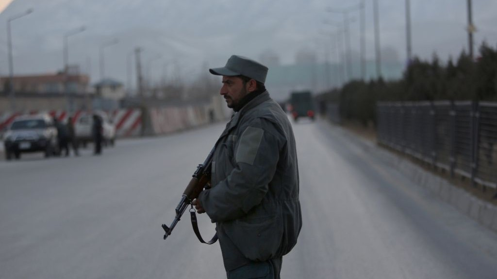 A member of the Afghan security forces stands guard near the site of two blasts in Kabul, Afghanistan, Tuesday, January 10, 2017. (AP Photo/Rahmat Gul)