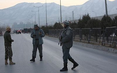 Afghan security forces stand guard near the site of two blasts in Kabul, Afghanistan, Tuesday, January 10, 2017. (AP Photo/Rahmat Gul)