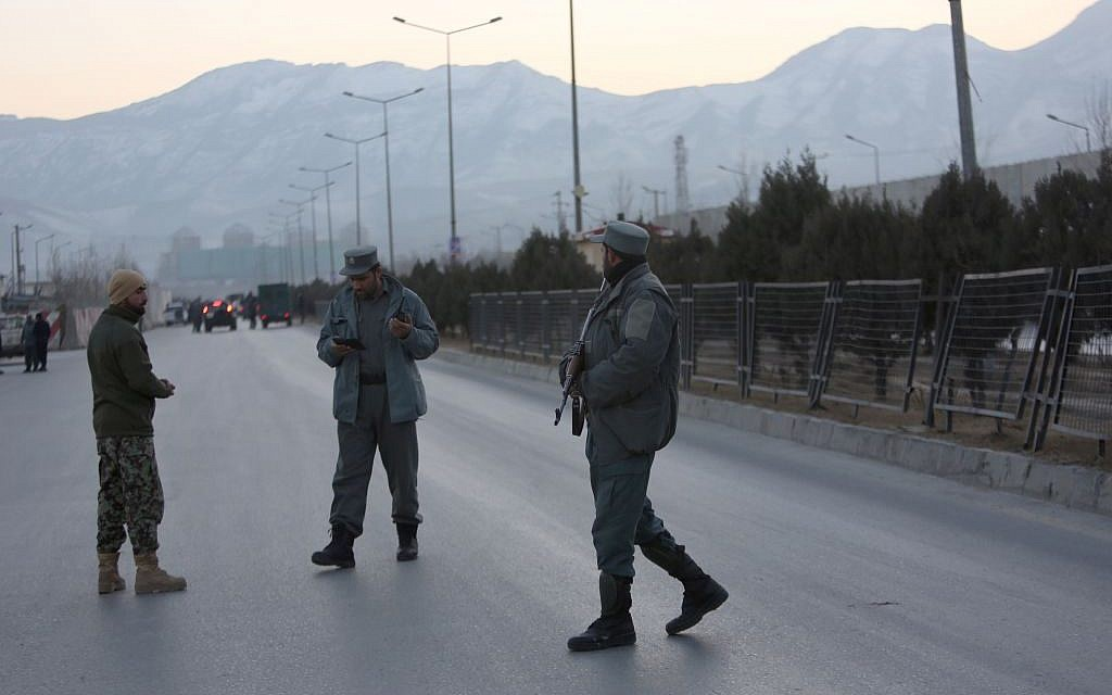 Afghan security forces stand guard near the site of two blasts in Kabul, Afghanistan, Tuesday, Jan. 10, 2017. Two loud explosions have rocked the Afghan capital of Kabul, causing casualties. The target of the blasts was probably an area that includes government and lawmakers' offices. Sediq Sediqqi, spokesman for the Interior Ministry, said that first, a suicide bomber carried out an attack, followed by a second explosion, caused by car bomb parked near the site. (AP Photo/Rahmat Gul)