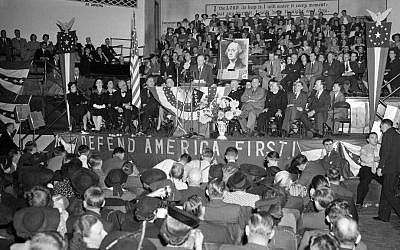 A crowd of over 4,000 people filled the Gospel Tabernacle in Fort Wayne, Indiana, to hear Col. Charles Lindbergh, seen on the speaker's stand in the center, address a rally of the America First Committee. (AP Photo/File)