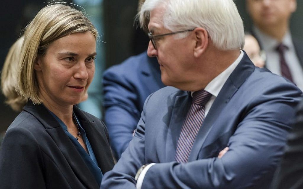 EU foreign policy chief Federica Mogherini, left, talks with German Foreign Minister Frank-Walter Steinmeier during an EU foreign ministers meeting at the EU Council in Brussels on Monday, January 16, 2017. (AP/Geert Vanden Wijngaert)