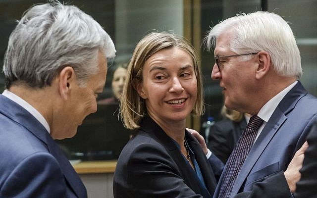 EU foreign policy chief Federica Mogherini, center, talks with German Foreign Minister Frank-Walter Steinmeier, right and Belgium's Foreign Minister Didier Reynders during an EU foreign ministers meeting at the EU Council in Brussels on Monday, Jan. 16, 2017. (AP/Geert Vanden Wijngaert)