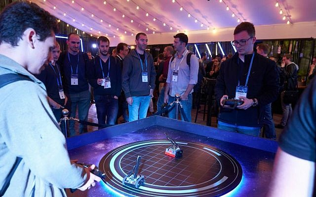 Participants at Microsoft's first BlueHat cybersecurity conference in Tel Aviv on 24-15 January 2017 play with Sumo Bots (Courtesy)