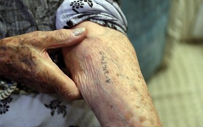 In this Dec.19, 2016 photo, Auschwitz survivor Cyrla Gewertz shows a number tattooed on her arm when she was a prisoner at the concentration camp, during an interview in Sao Paulo, Brazil. (AP Photo/Andre Penner)