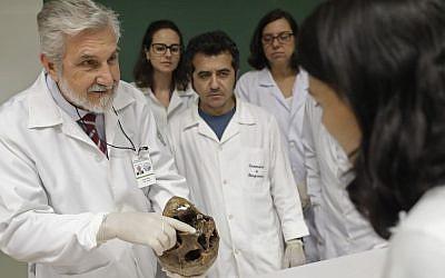 Forensic doctor Daniel Muniz displays the skull of Nazi war criminal Josef Mengele at the School of Medicine, University of Sao Paulo, Brazil, December 7, 2016.  (AP/Andre Penner)