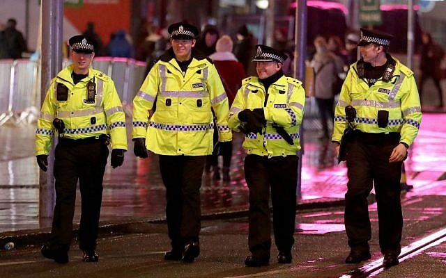 Police officers patrol in Princes Street, Edinburgh, prior to the Hogmanay New Year celebrations in Scotland, Saturday, Dec. 31, 2016. (Andrew Milligan/PA via AP)