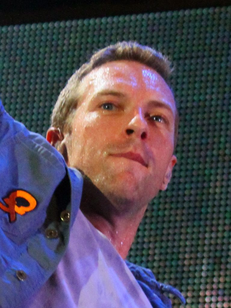 "Chris Martin, performing with Coldplay, at the Naeba Ski Resort, Niigata, Japan, as part of the 2011 Fuji Rock Festival. (Christopher Johnson (globalite) on Flickr - ""Fuji Rock photos: Coldplay"" / Wikipedia)"