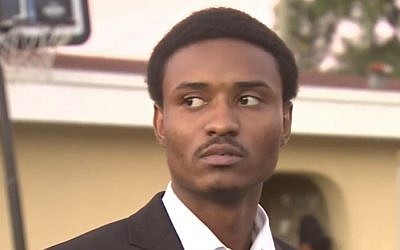 Deandre Charles, accused of killing Rabbi Joseph Raksin in 2014 ,seen outside his home after charges against him were dropped January 18, 2017 (Screen capture: WSVN News)