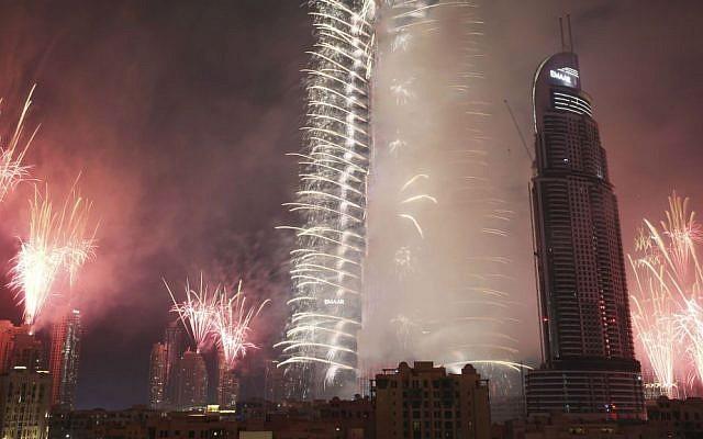 Fireworks explode at the Burj Khalifa, the world's tallest building, and surrounding skyscrapers to mark New Year in Dubai, United Arab Emirates, on Sunday, Jan. 1, 2017. (AP Photo/Jon Gambrell)