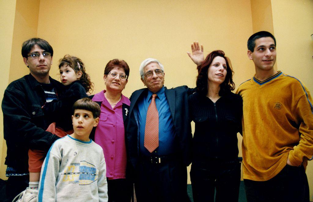 Yitzhak Banai (c) stands in an undated photo with his family, including his children Meir Banai (l), Evyatar Banai (r) and Orna Banai (second r) (Moshe Shai/Flash 90)