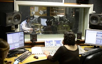 Illustrative: Radio broadcasters at Army Radio headquarters in Jaffa, on March 27, 2014. (Tomer Neuberg/Flash 90)