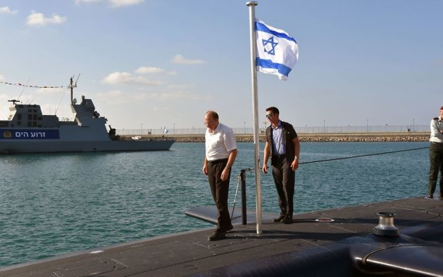 Then-defense minister Moshe Ya'alon aboard the INS Tanin submarine as it docks for the first time at the Haifa Port, September 23, 2014. (Ariel Hermoni/Ministry of Defense/ FLASH90)