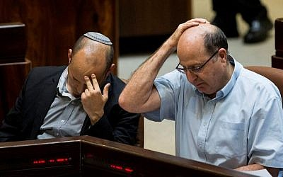 Then defense minister Moshe Ya'alon (R) seen with Education Minister Naftali Bennett during a plenum session at the plenary in the Knesset on May 25, 2015. (Yonatan Sindel/Flash90)