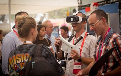 Participants at the DLD Tel Aviv Digital Conference, Israel's largest international Hi-tech gathering, featuring hundreds of start ups, VC's, angel investors and leading multinationals, held at the Old Train Station complex in Tel Aviv on September 8, 2015. (Miriam Alster/FLASH90)