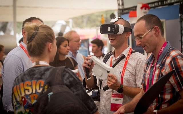 Illustrative: Participants at the DLD Tel Aviv Digital Conference, Israel's largest international Hi-tech gathering, featuring hundreds of start ups, VC's, angel investors and leading multinationals, held at the Old Train Station complex in Tel Aviv on September 8, 2015. (Miriam Alster/FLASH90)