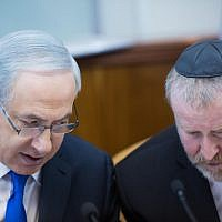 Prime Minister Benjamin Netanyahu, left, speaks with then-cabinet secretary Avichai Mandelblit, right, during a weekly cabinet meeting in Jerusalem, on December 20, 2015. (Yonatan Sindel/Flash90)
