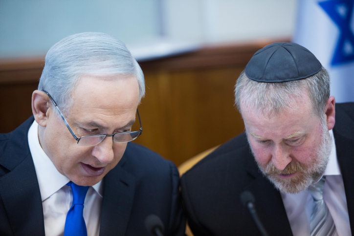 Prime Minister Benjamin Netanyahu, left, speaks with his former cabinet secretary Avichai Mandelblit, right, now the attorney general, during the weekly government conference in Jerusalem, on December 20, 2015. (Yonatan Sindel/Flash90)