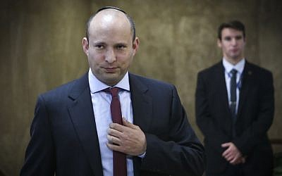 Education Minister Naftali Bennett arrives for the weekly cabinet meeting at the Prime Minister's Office in Jerusalem, January 1, 2017. (Alex Kolomoisky)