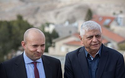 Education minister and Jewish Home party leader Naftali Bennett (L) and mayor of Ma'ale Adumim Benny Kasriel before the start of a special party faction meeting, in Maale Adumim, January 2, 2017.(Yonatan Sindel/Flash90)