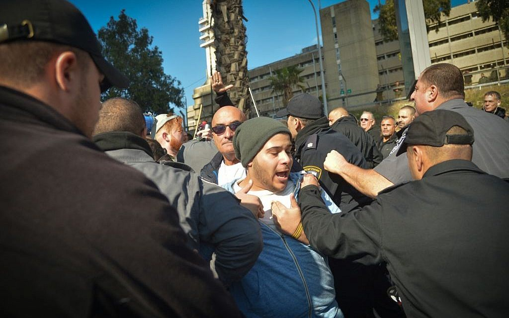 Following the conviction at of IDF Sgt. Elor Azaria for the manslaughter of a Palestinian attacker, police detain a demonstrator during a protest in support of  the soldier, outside the courtroom in the Kirya military base, Tel Aviv, January 4, 2017. (Flash90)
