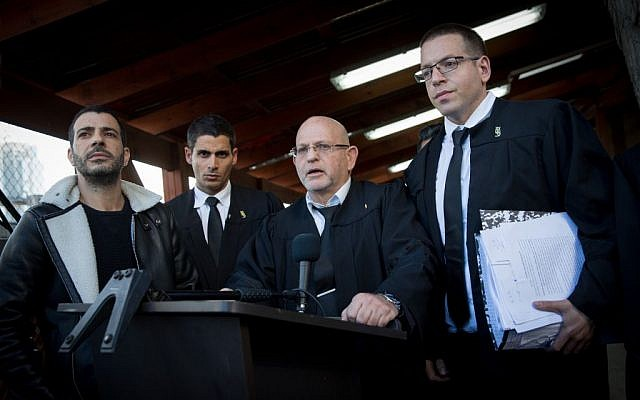 Attorneys Ilan Katz, center, and Eyal Besserglick, right, the legal team of IDF Sgt. Elor Azaria speak to press at the Kirya military base in Tel Aviv following a verdict on January 4, 2017. (Miriam Alster/FLASH90)