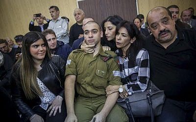Elor Azaria, an Israeli soldier who shot a Palestinian terrorist in Hebron, sits in the courtroom before the announcement of his verdict at the Kirya military base in Tel Aviv on Wednesday, January 4, 2017 (Miriam Alster/Flash90)