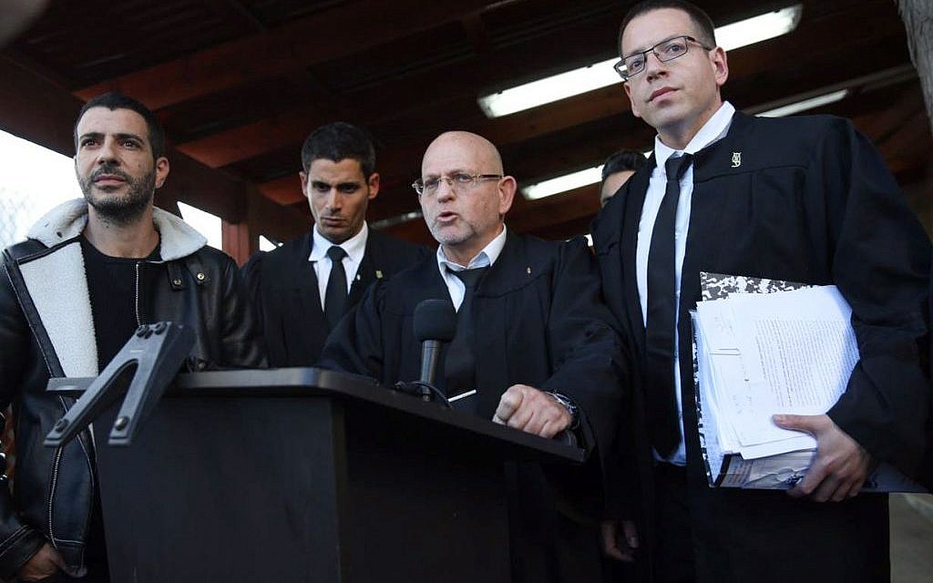 Following his manslaughter conviction for shooting a mortally wounded Palestinian attacker in Hebron, the legal team for IDF Sgt. Elior Azaria, speak to the press outside the courtroom at the Kirya military base Tel Aviv,  January 4, 2017. (Miriam Alster/Flash90)