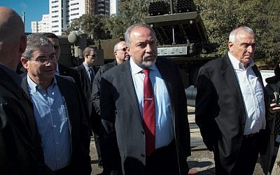 Defense Minister Avigdor Liberman, center, tours the Israel Military Industries factory, January 4, 2017. (Roy Alima/Flash90)