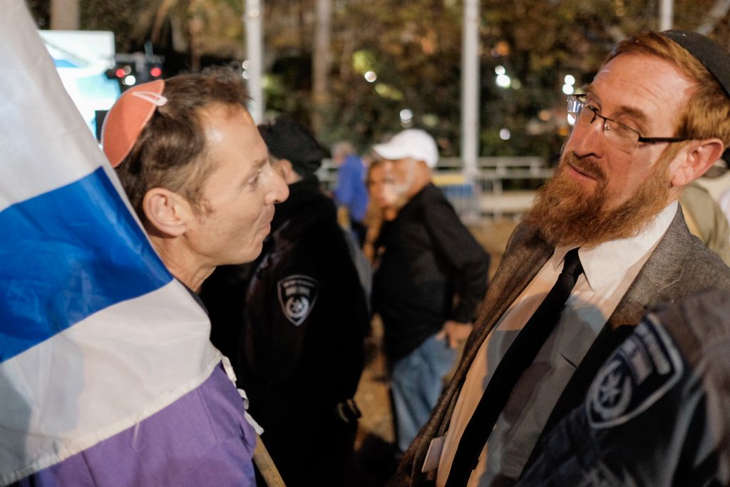 MK Yehuda Glick (right) attends an anti-incitement demonstration at Rabin Square in Tel Aviv on January 7, 2017. (Tomer Neuberg/Flash90)