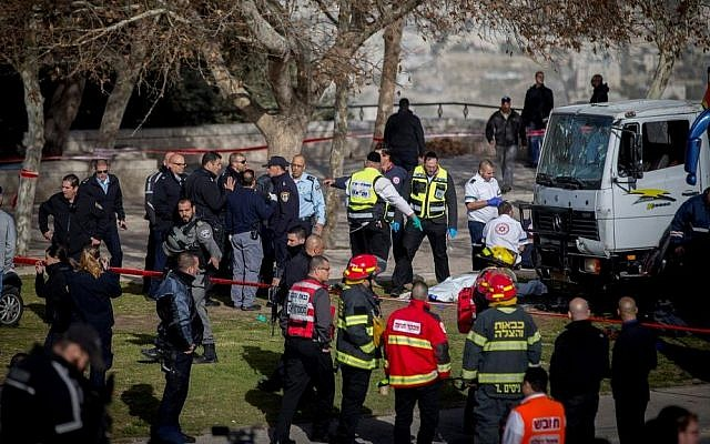 The scene of a truck-ramming attack in which a truck plowed into a group of Israeli soldiers, killing four and injuring 16, in the Armon Hanatsiv neighborhood of Jerusalem. January 08, 2017. (Yonatan Sindel/Flash90)