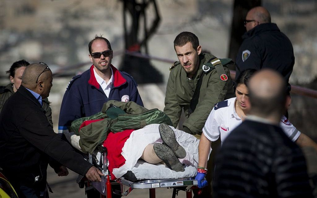 The scene where a truck rammed into a group of Israeli soldiers, killing at least four in a suspected vehicle-ramming attack, in the Armon Hanetziv neighborhood of Jerusalem.  (Yonatan Sindel/Flash90)