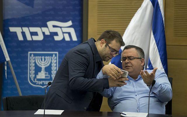 Likud parliament members David Bitan (R) and Oren Hazan seen during a Likud faction meeting in the Knesset, January 9, 2017. (Yonatan Sindel/Flash90)