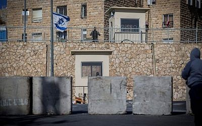 Illustrative. Israeli Border Police officers guard near a road block at the entrance to the East Jerusalem neighborhood of Jabel Mukaber on January 09, 2017. (Yonatan Sindel/Flash90)