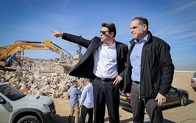 Chief foreign envoy of the Yesha council Oded Revivi, right, and Science Minister Ofir Akunis surveying new construction in the settlement of Efrat on January 16, 2017. (Gershon Elinson/Flash90)