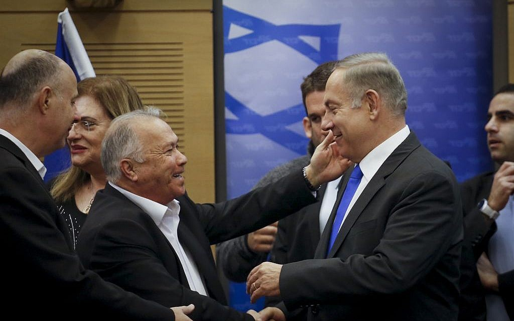 Benjamin Netanyahu greeted by a supporter as he arrives to a Likud faction meeting on January 16, 2017. (Yonatan Sindel/Flash90)