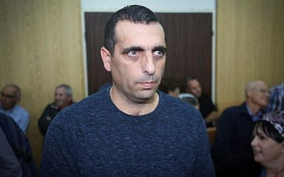 Ofek Buchris, a former IDF general accused of rape and other sexual crimes against subordinates, arrives with his wife Naama, to the Jaffa military court on January 17, 2017. (Flash90)