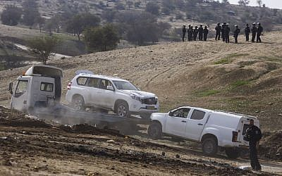 The car which was used in a car ramming attack, killing an Israeli police man, during clashes and protests against demolition of homes in the Bedouin village of Umm al-Hiran in the Negev desert, Southern Israel, January 18, 2017. (Hadas Parush/Flash90)