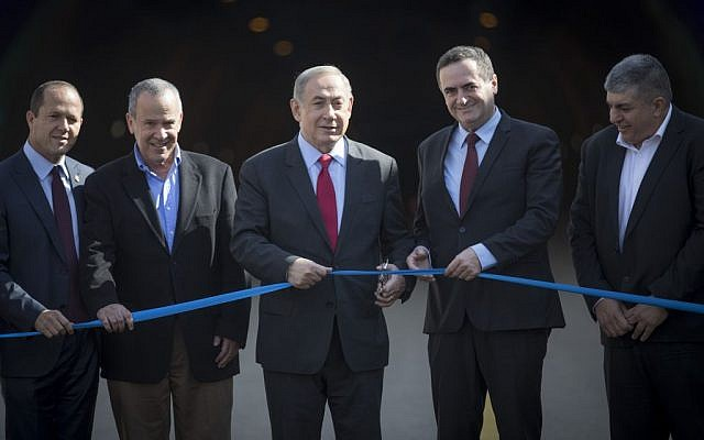 Prime Minister Benjamin Netanyahu (C), Jerusalem Mayor Nir Barkat (L) and Transportation Minister Yisrael Katz (2R) attend an opening ceremony for the new Harel Tunnel on the main Tel Aviv-Jerusalem highway on January 19, 2017. (Photo by Yonatan Sindel/Flash90)
