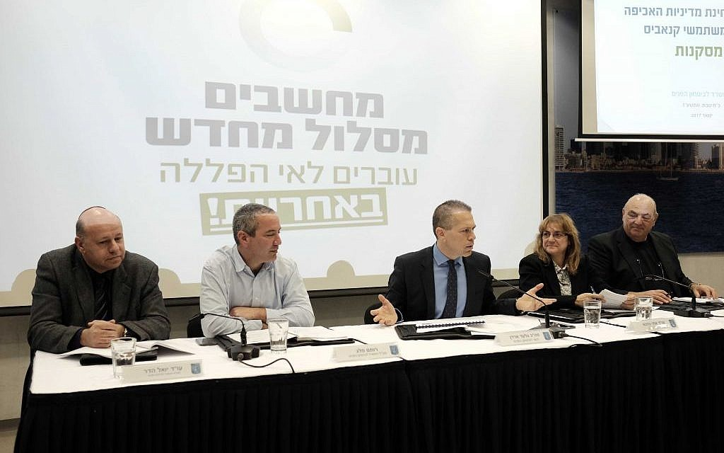 Public Security Minister Gilad Erdan (C) holds a press conference in Tel Aviv to announce his support for a new marijuana policy on January 26, 2017 (Photo by Tomer Neuberg/Flash90)