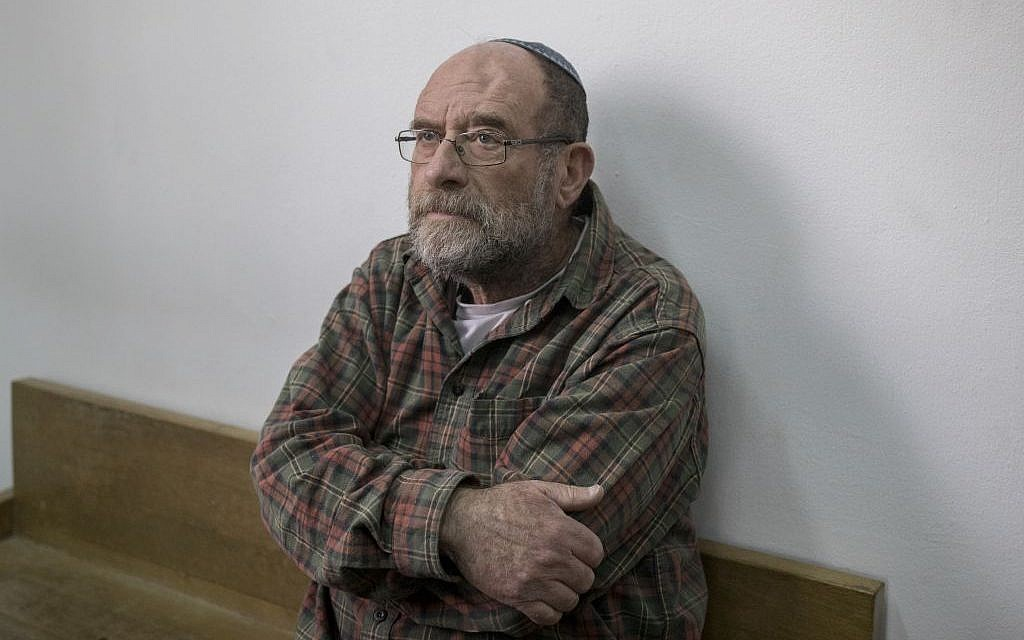Yossi Barkan, the exterminator who left the poison that led to the deaths of young sisters Avigail and Yael Gross attends a court hearing in Jerusalem District Court on January 26, 2017. (Photo by Yonatan Sindel/Flash90)