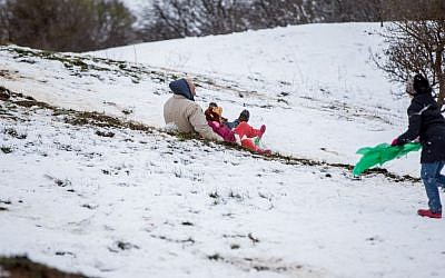 Israelis play in the snow in the Golan Heights, on January 28, 2017 (Basel Awidat/Flash90)