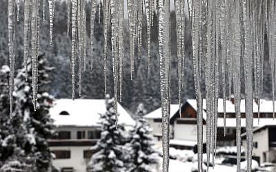 Icicles hang from a roof of a house in Oberstdorf, southern Germany, Sunday Jan. 8, 2017. Karl-Josef Hildenbrand/dpa via AP)