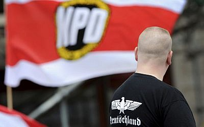 In this June 17 2012 file picture a supporter of the National Democratic Party, NPD attends a rally in Berlin (Matthias Balk/dpa via AP,file)