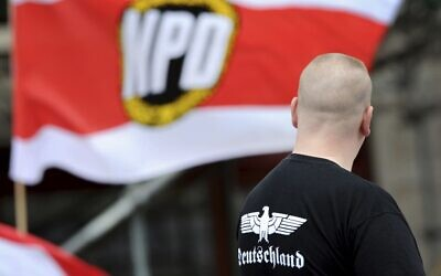 In this June 17, 2012, photo, a supporter of the National Democratic Party, NPD, attends a rally in Berlin (Matthias Balk/dpa via AP,file)