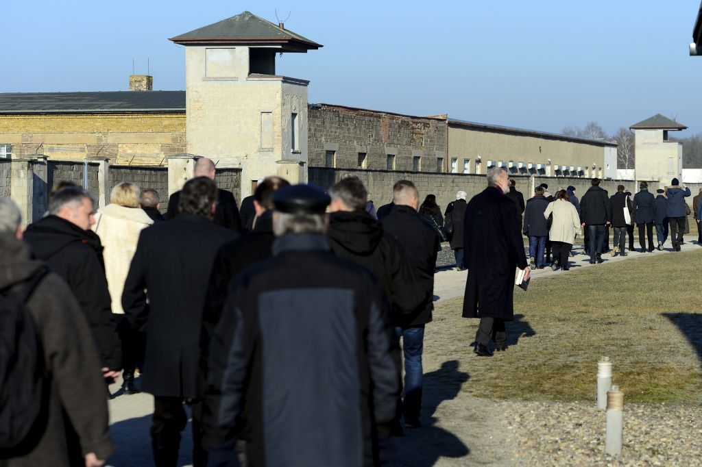Visitors walk at the Sachsenhausen concentration camp memorial in Oranienburg, Germany, Friday, Jan. 27, 2017 on the Holocaust Remembrance Day. (Maurizio Gambarini/dpa via AP)