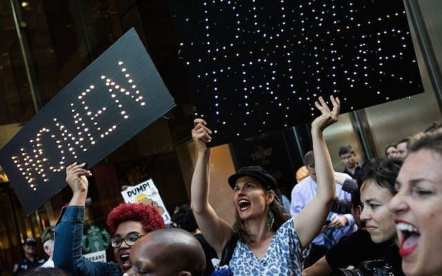 A group of protestors, comprised mostly of women, rally against Republican presidential candidate Donald Trump outside of Trump Tower, November 3, 2016 in New York City.(Drew Angerer/Getty Images)