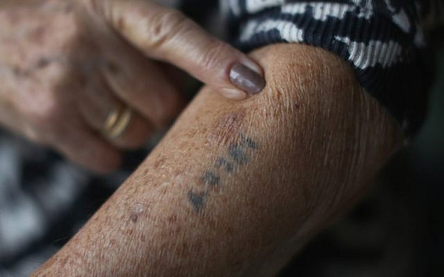 A Holocaust survivor shows her number tattoo. (Christopher Furlong/Getty Images)